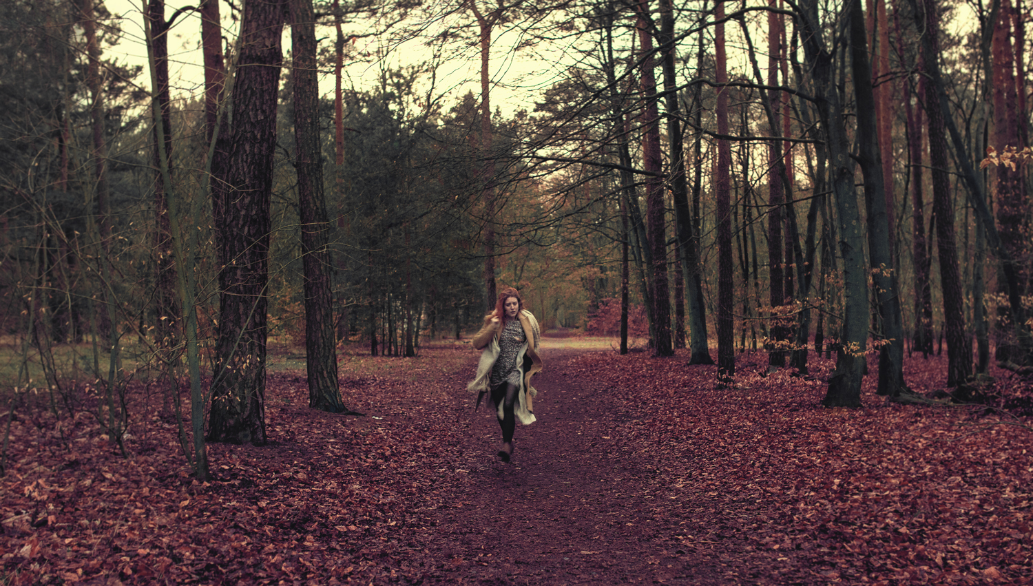 girl red hair red leaves forest running bur cant see way out